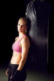 Portrait of Female Boxer. Vertical portrait of a young beautiful female boxer Stock Photo