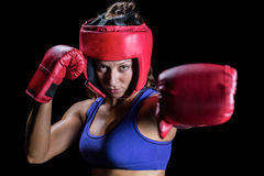 Portrait of female boxer with gloves and headgear Stock Photo