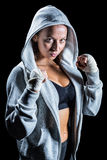 Portrait of female boxer in hood with fighting stance Stock Photos