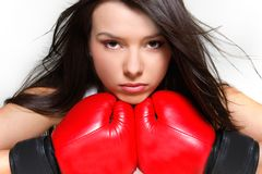 Portrait of female boxer over white Royalty Free Stock Images