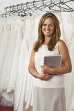 Portrait Of Female Bridal Store Owner With Digital Tablet Stock Photos