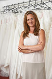Portrait Of Female Bridal Store Owner With Wedding Dresses Royalty Free Stock Photography
