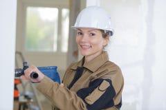 Portrait female builder Stock Photography