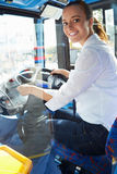 Portrait Of Female Bus Driver Behind Wheel Royalty Free Stock Photos