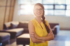 Portrait of female business executive standing with arms crossed Stock Photos