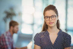 Portrait of female business executive wearing spectacles. In office Stock Images