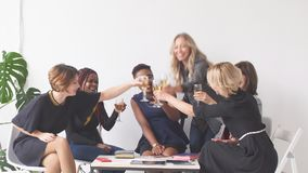 Portrait of female business team in modern studio with glasses of champagne. stock video
