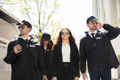 Portrait Of Female Celebrity With Bodyguards stock photography