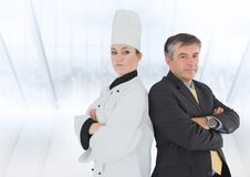 Portrait of female chef and businessman with arms crossed Royalty Free Stock Photos