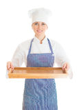 Portrait of female chef cook holding tray. Stock Image