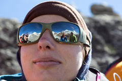 Portrait of female Climber in warm Cap and Sunglasses Stock Photos