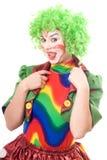 Portrait of female clown showing tongue Stock Image