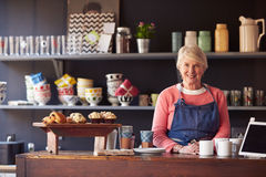 Portrait Of Female Coffee Shop Owner Standing Behind Counter Royalty Free Stock Image