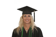 Portrait female college graduate with honors. Isolated against white background Royalty Free Stock Photos