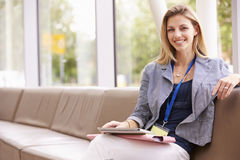 Portrait Of Female College Tutor With Digital Tablet Stock Photo
