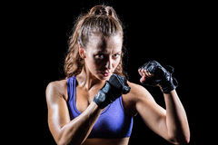 Portrait of female confident boxer with fighting stance Stock Images