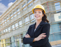 Portrait of Female Contractor Wearing Hard Hat at Construction S Stock Photo