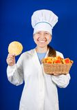 Portrait of female cook with cookie Stock Photo