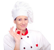 Portrait of the female cook in uniform isolated on white. Royalty Free Stock Photos