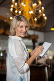 Portrait of female costumer maintain record in notepad Royalty Free Stock Images