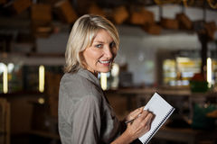 Portrait of female costumer maintain record in notepad Royalty Free Stock Photo