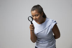 Portrait Of Female Criminologist With Magnifying Glass Stock Photos