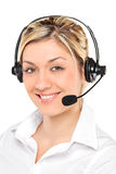 Portrait of a female customer service operator. Portrait of a young female customer service operator wearing a headset isolated on white background Royalty Free Stock Photos