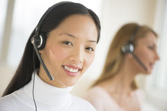 Portrait Of Female Customer Service Representative Smiling At Of Royalty Free Stock Photos