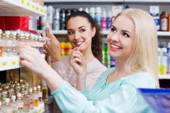 Portrait of female customers shopping. In beauty store Royalty Free Stock Images