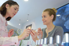 Portrait female customers shopping in beauty store. Portrait of female customers shopping in beauty store Royalty Free Stock Images