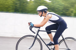 Portrait of female cyclist on a track Royalty Free Stock Photography