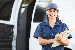 Portrait Of Female Delivery Driver With Clipboard. Smiling To Camera Stock Images