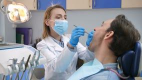 Portrait of female dentist examining patient