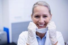 Portrait of female dentist smiling Stock Photo