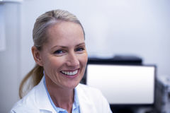 Portrait of female dentist smiling Royalty Free Stock Images