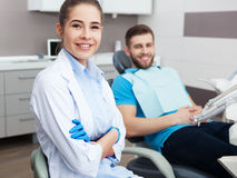 Portrait of a female dentist and young happy  male patient. Royalty Free Stock Photography