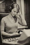 Portrait of female dj working Royalty Free Stock Photography
