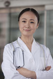 Portrait of female doctor with arms crossed outside of the hospital Royalty Free Stock Image