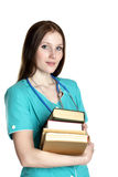 Portrait of female doctor with books Stock Photography