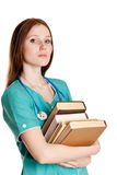 Portrait of female doctor with books Royalty Free Stock Photos