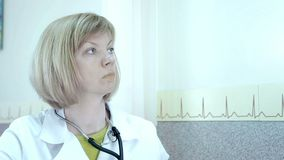 Portrait of a female doctor. The doctor ultrasound diagnoses.  stock video