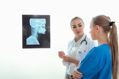 Portrait of female doctor are examining X-Ray film in examination room, Healthcare and occupational concept. Portrait of female doctor are examining X-Ray film royalty free stock photos