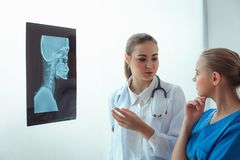 Portrait of female doctor are examining X-Ray film in examination room, Healthcare and occupational concept. Portrait of female doctor are examining X-Ray film stock images