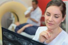 Portrait female doctor examining xray in hospital Royalty Free Stock Photo