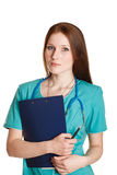 Portrait of female doctor in the green uniform Royalty Free Stock Photography