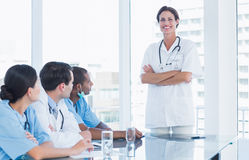 Portrait of a female doctor with her team Royalty Free Stock Photography