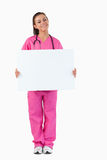 Portrait of a female doctor holding a blank panel Royalty Free Stock Images