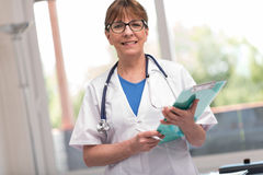 Portrait of female doctor holding a clipboard Stock Image
