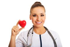 Portrait of female doctor holding heart model.  stock photography