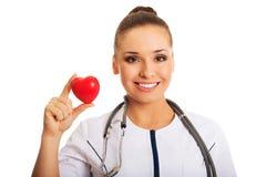 Portrait of female doctor holding heart model Stock Photography